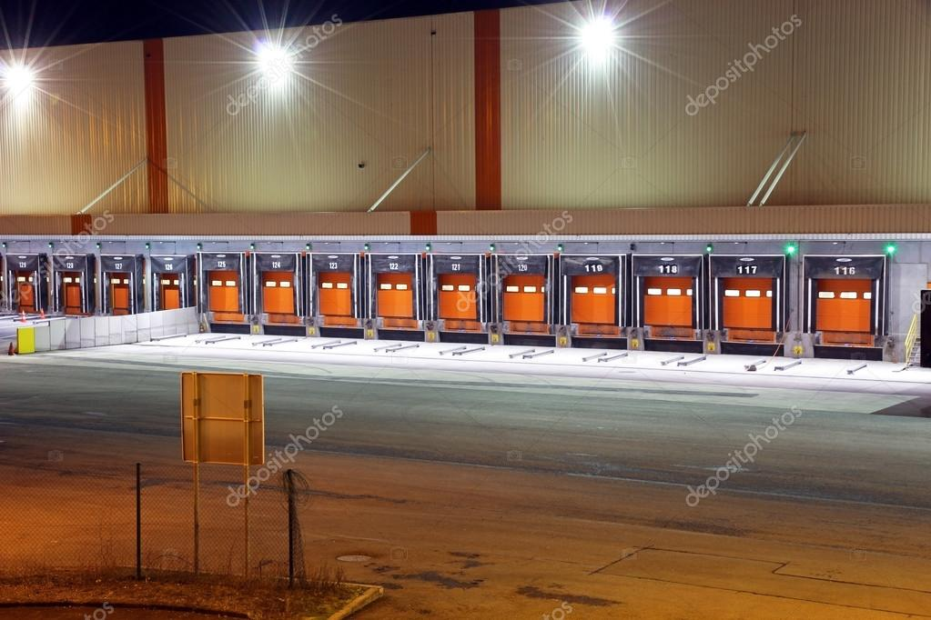 gates for trucks on a warehouse at night