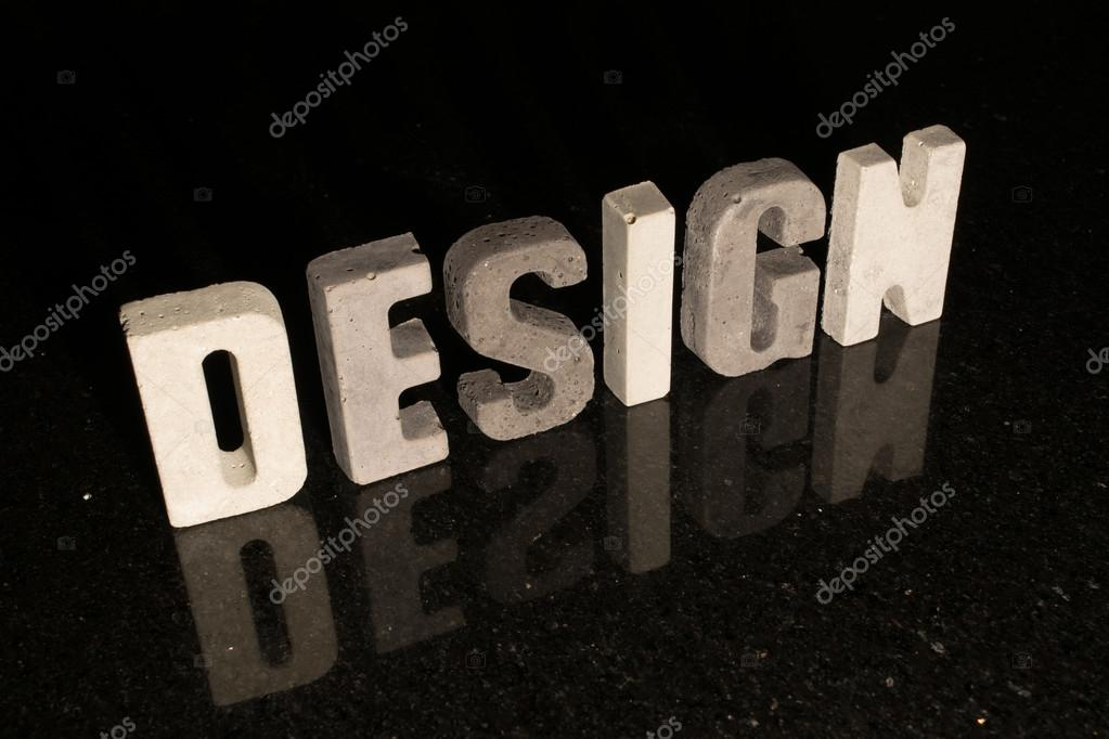 Design di parola come lettere grigio cemento su mattonelle nere