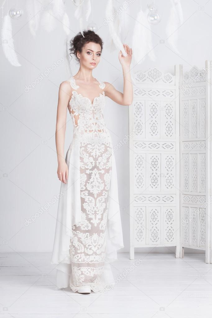 Tall and slim young bride in a luxurious lace wedding dress. — Stock ...