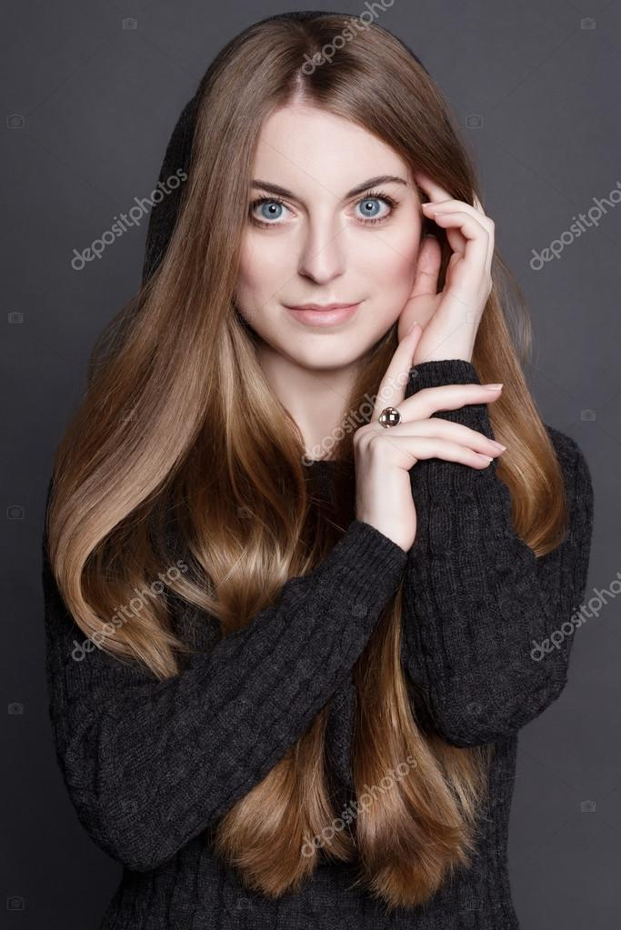Young Attractive Woman With Long Gorgeous Dark Blond Hair And Large