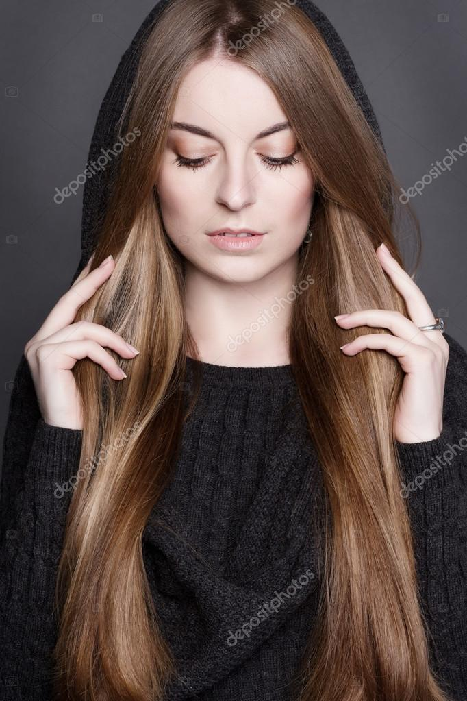 Ortrait Of A Young Beautiful Woman With Long Gorgeous Dark Blond