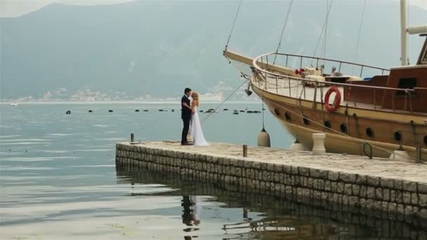 Bride and groom kissing on the berth on Montenegro, Budva