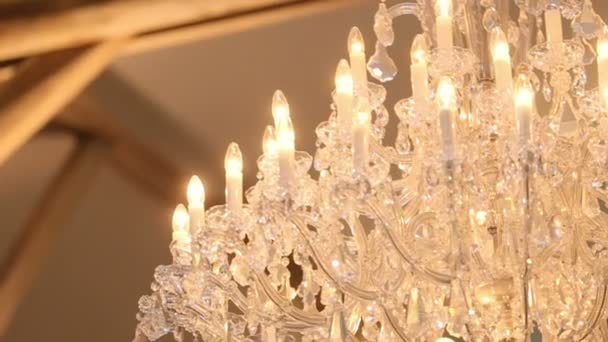 Luxury crystal chandelier close up. Beautiful expensive interior of wedding hall