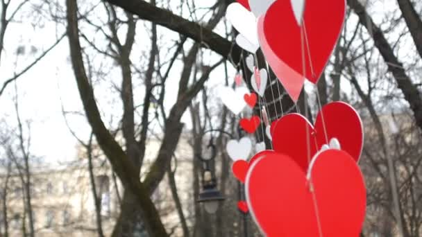 Paper red hearts decoration swaying on the wind  in the autumn park. Valentines day concept