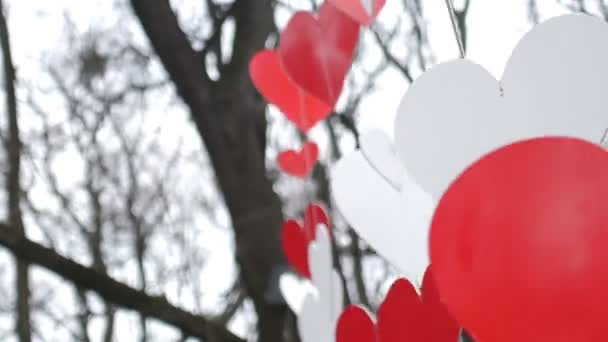 Love heart balloons on sky background. Paper red hearts decoration in the autumn park. Valentines day concept