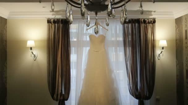 Beautiful white stylish wedding dress on hanger on the background of ...