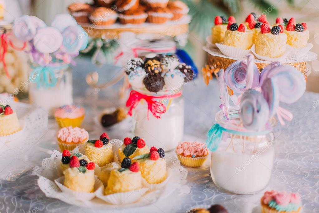 Sweet holiday buffet with cupcakes and other desserts. Candy Bar