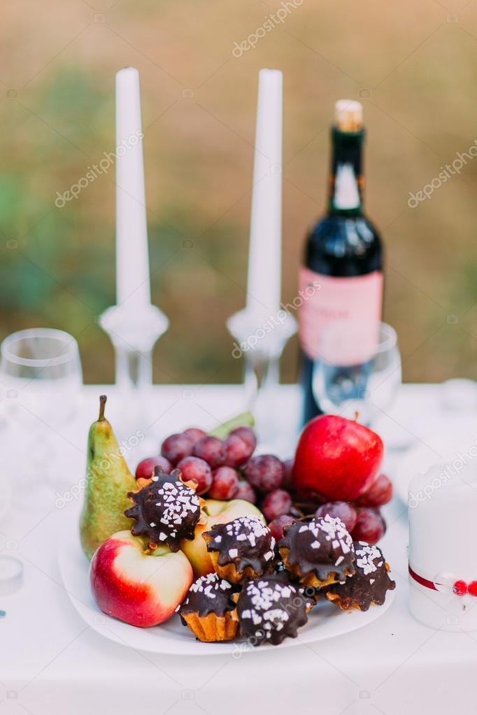 Outdoor romantic dinner table settings with wine glasses sweets and candles u2014 Stock Photo & Outdoor romantic dinner table settings with wine glasses sweets ...