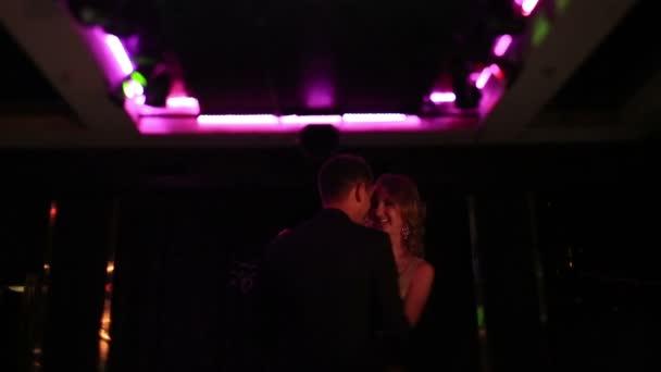 Lovers dancing on the dance floor. Dance of lovers. Dancing feet. Dancing in night clubs.