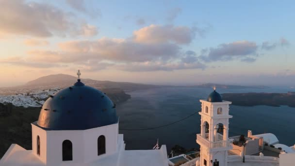 Santorini Church with blue dome by Aegean Sea. Church bells on Santorini island which is one of the famous tourist attraction. Time lapse