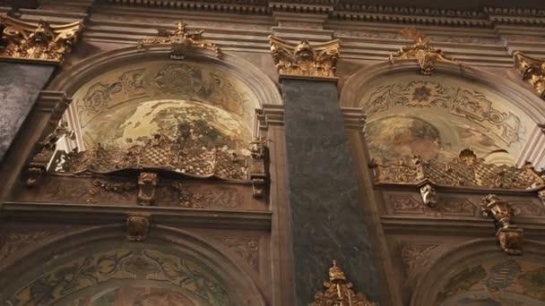 Old Jesuit Church in Lviv, Ukraine. Baroque interior with antique damaged frescoes