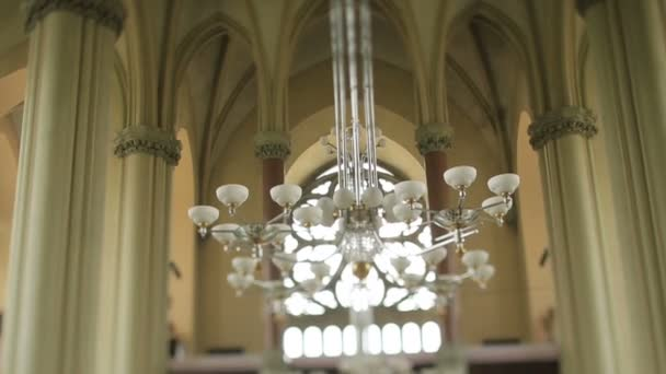 Large modern chandelier in the nave of old gothic church