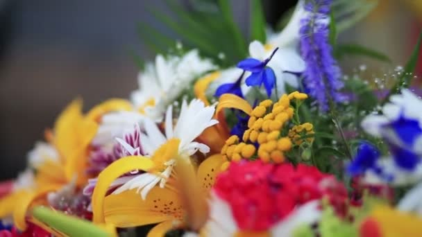 Close up of huge bouquet consisting of lilacs, roses, tulips, lilies, daisies  and other spring colorful flowers