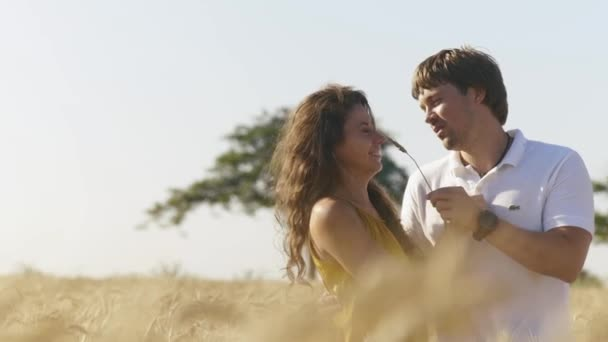 Man and woman at wheat field under have fun and laughing