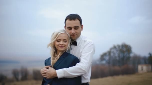 Attractive young couple in love softly embracing in the cold autumn day. Love warms
