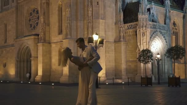 Gorgeous wedding couple softly embracing in magnificent Budapest background in hot summer night