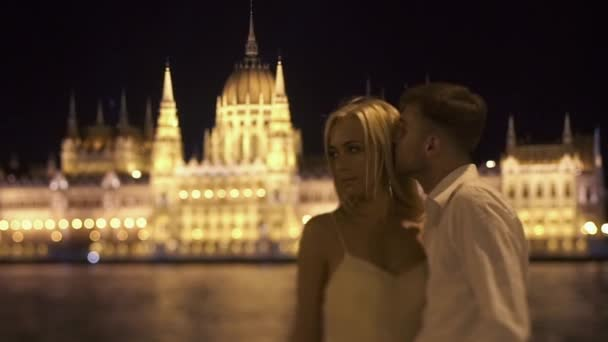 Charming couple in love in Budapest at night enjoying the breathtaking view.