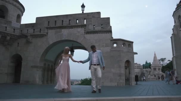 Elegant couple in love have a romantic walk in Budapest, Hungary. Honeymoon concept