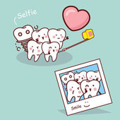 Fotografie Happy cartoon tooth take selfie