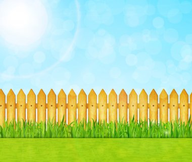 Garden background with green grass and wooden fence