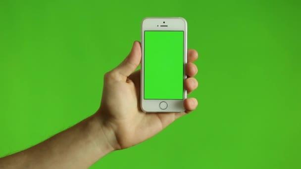 Ujjával mutatva okos telefon, egy zöld Chroma