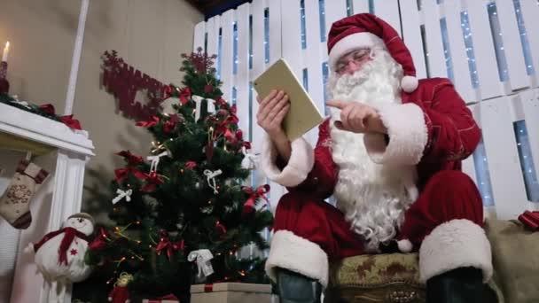 Santa fordul oldal a digitális tabletta vásárlás és fizetés ajándékok.