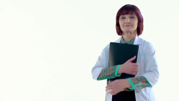 Female Doctor Hugging a Black Folder and Looking at the Camera, Laughing