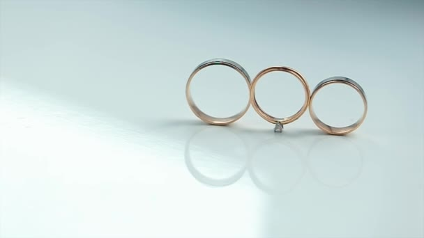 Gold Rings are on a White Background