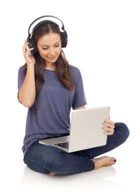 Girl with laptop and headphones