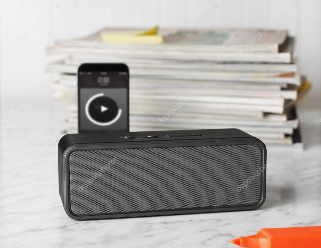 Portable speaker  on a table