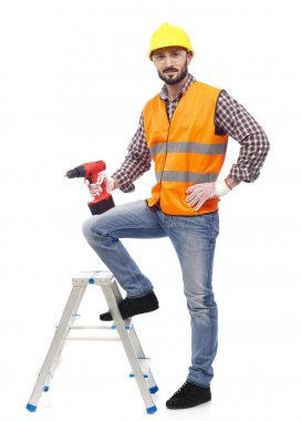 Carpenter with safety vest and drill