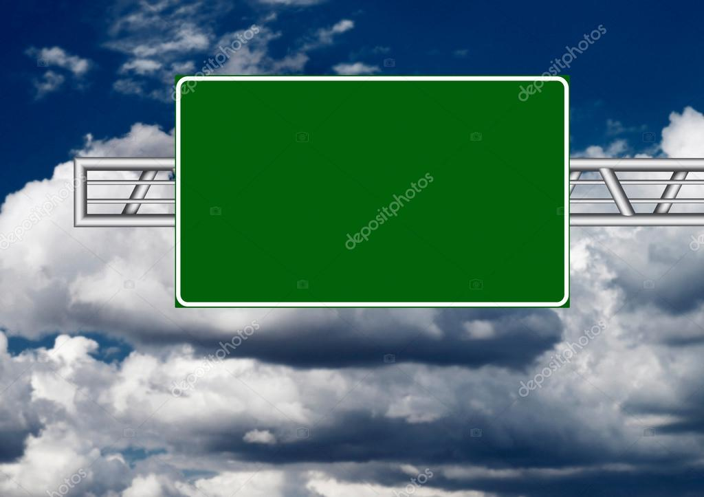 Highway sign over dark sky