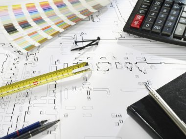 Blueprints and office supplies