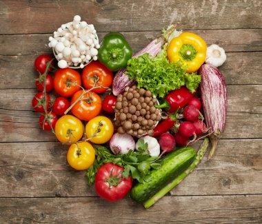 Vegetables heart on wood table