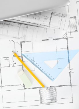 Blueprints and office supplies with copy space stock vector