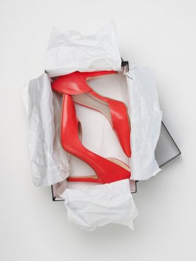 Red high heels in box