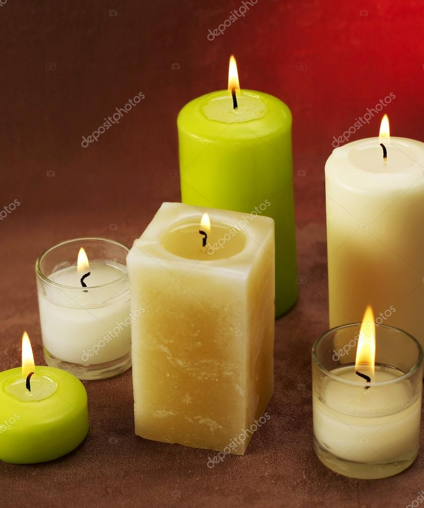 Candles on red background