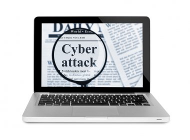Cyber attack under magnifying glass on a laptop