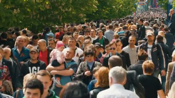 Large Group of People Walking at City