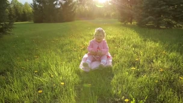 Smiling Child Sitting on the Grass