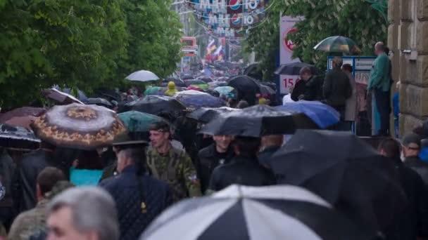 People with Umbrellas Walk Under the Rain 6