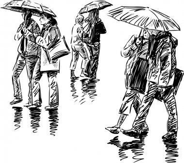 pedestrians under umbrellas