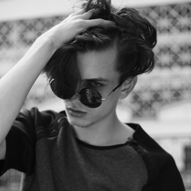 Stylish man in the sunglasses outdoor black and white portrait
