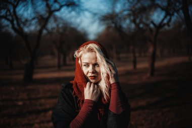 Mysterious lonely woman in autumn park