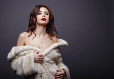 Beauty Fashion Model Girl in Fur Coat. Beautiful Luxury Winter Woman