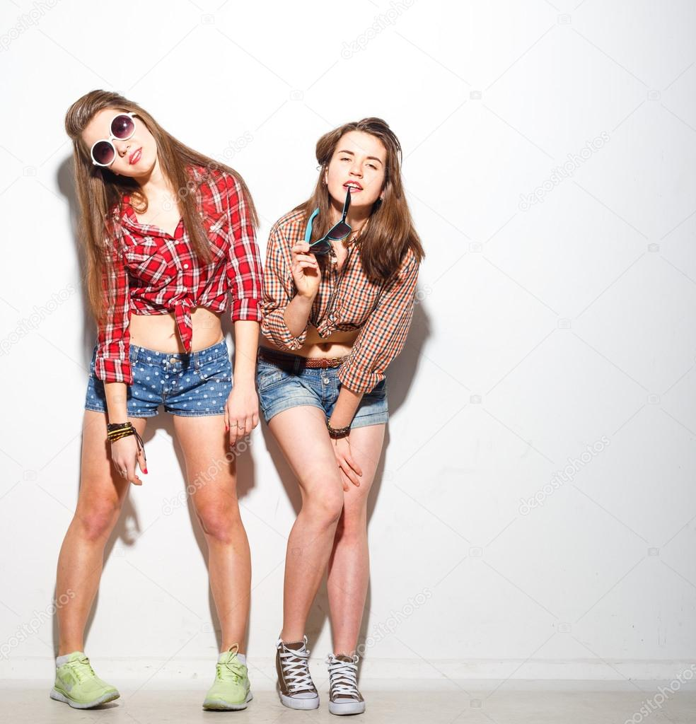 eae07efa3c3fa Close up fashion lifestyle portrait of two young hipster girls best  friends