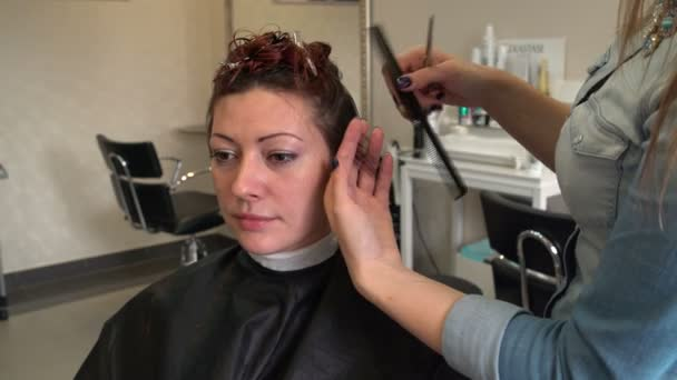 Stylist combing the hair strand