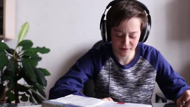 Boy Listening Music in Headphones and Singing
