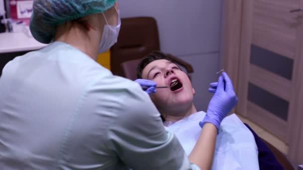 Teenager boy at a reception at the dentist