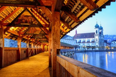 View through historical wooden Chapel Bridge to the old town of Lucerne, Switzerland
